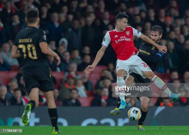 Gabriel Martinelli of FC Arsenal and Frederico Venancio of Vitoria Guimaraes battle for the ball during the UEFA Europa League group F match between...