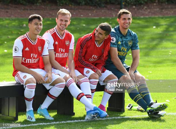 Gabriel Martinelli Rob Holding Lucas Torreira and Emi Martinez of Arsenal during the Arsenal 1st team squad photo at London Colney on September 27...