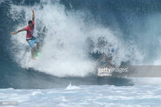 Gabriel Medina drop in and almost crash into Kelly Slater in the 2017 Billabong Pipe Masters on December 18 2017 in Pupukea Hawaii
