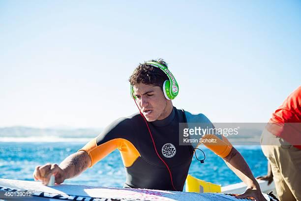 Gabriel Medina of Brasil waxes his surfboard at the Fiji Pro on June 5 2014 in Tavarua Fiji