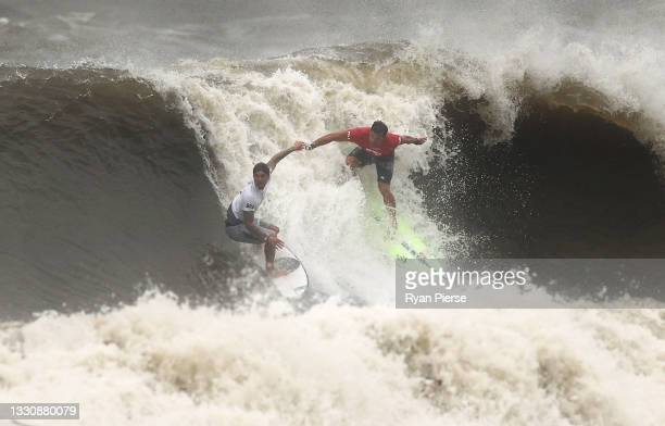 Gabriel Medina of Team Brazil pulls a priority blocking move on Michel Bourez of Team France during their men's Quarter Final on day four of the...