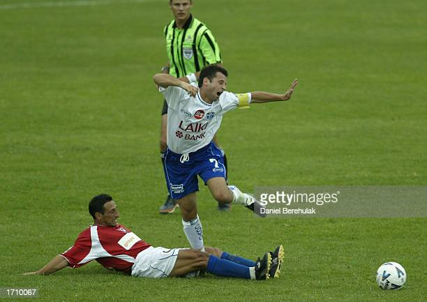 Gabriel Mendoza of United fouls Steve Panopoulos of South Melbourne during the NSL round 16 match between Sydney United and South Melbourne at the...