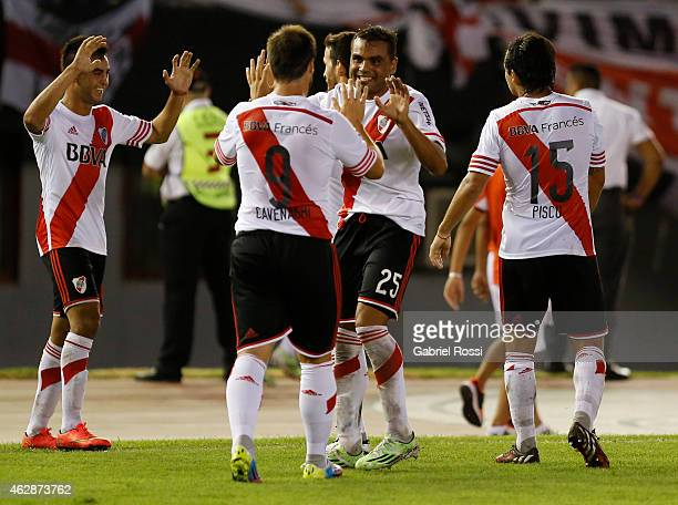 Gabriel Mercado and Fernando Cavenaghi of River Plate Plate celebrate after teammate Carlos Sanchez scored the first and winning goal of the team...