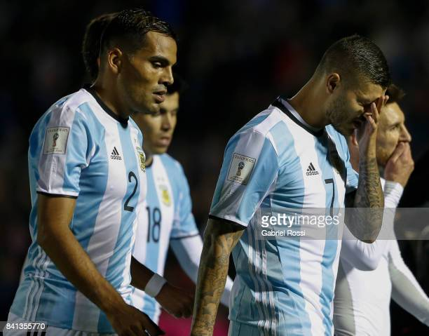 Gabriel Mercado Mauro Icardi and Lionel Messi of Argentina look dejected as they leave the field at the end of the first half during a match between...