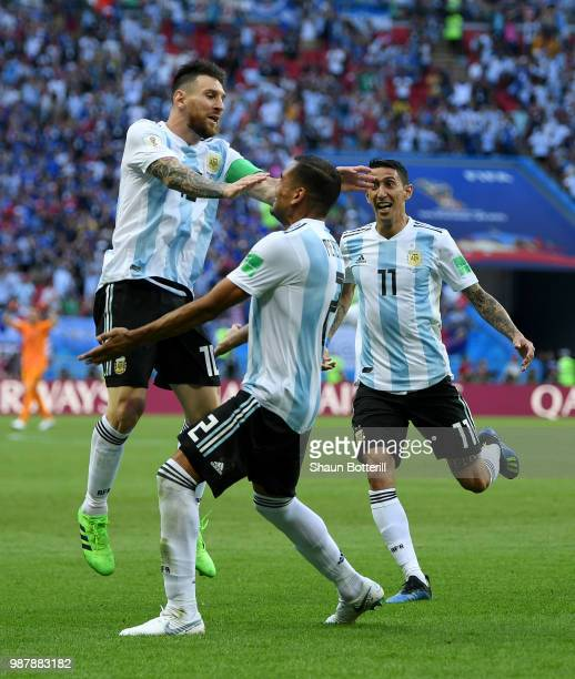 Gabriel Mercado of Argentina celebrates after scoring his team's second goal with team mate Lionel Messi during the 2018 FIFA World Cup Russia Round...