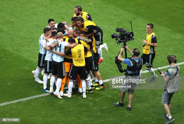 Gabriel Mercado of Argentina celebrates after scoring his team's second goal with team mates during the 2018 FIFA World Cup Russia Round of 16 match...