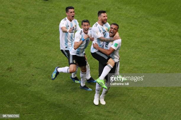 Gabriel Mercado of Argentina celebrates with teammate Lionel Messi after scoring his team's second goal during the 2018 FIFA World Cup Russia Round...