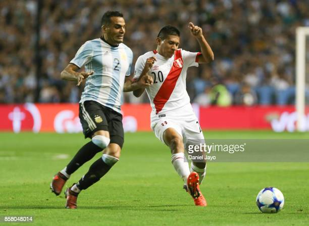 Gabriel Mercado of Argentina fights for the ball with Edison Flores of Peru during a match between Argentina and Peru as part of FIFA 2018 World Cup...