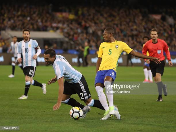 Gabriel Mercado of Argentina is challenged by Fernandinho of Brazil during the Brazil Global Tour match between Brazil and Argentina at Melbourne...
