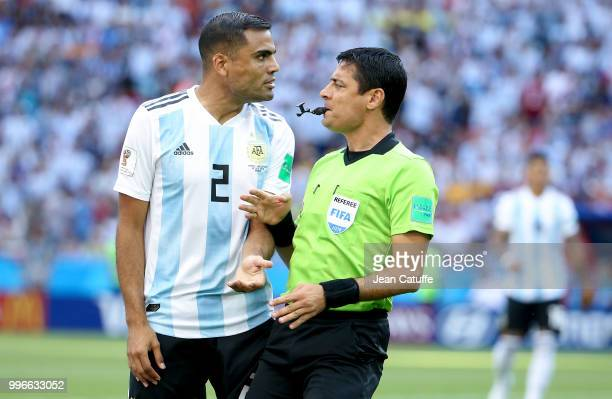 Gabriel Mercado of Argentina referee Alireza Faghani of Iran during the 2018 FIFA World Cup Russia Round of 16 match between France and Argentina at...
