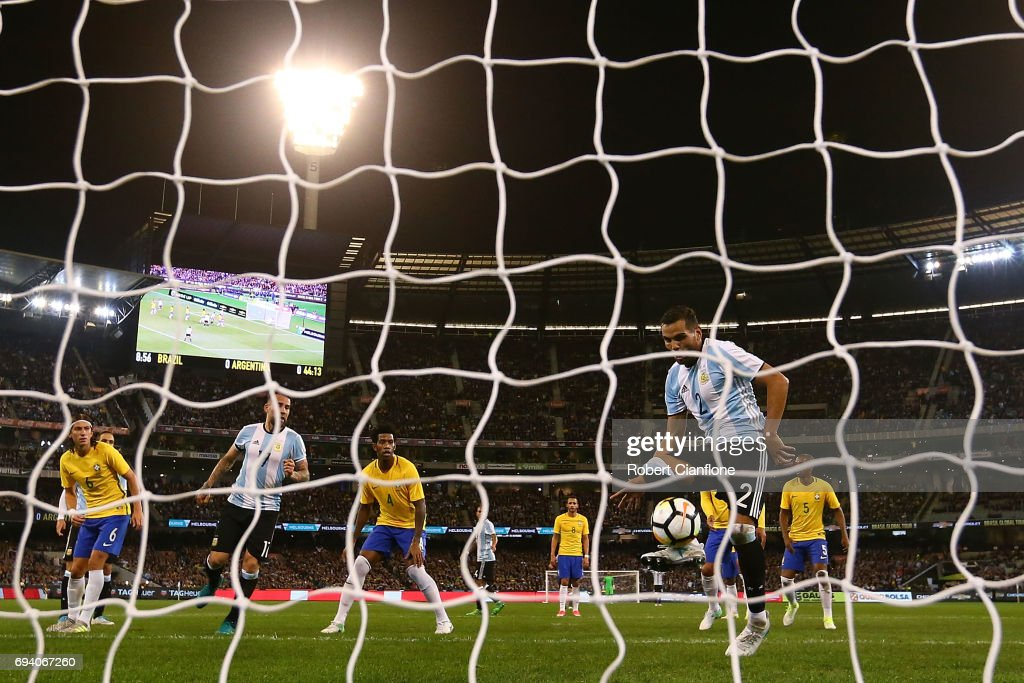 Gabriel Mercado of Argentina scores during the Brazil Global Tour match between Brazil and Argentina at Melbourne Cricket Ground on June 9, 2017 in Melbourne, Australia.