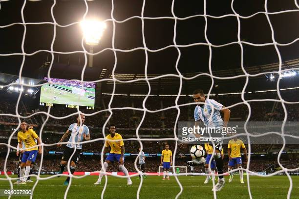 Gabriel Mercado of Argentina scores during the Brazil Global Tour match between Brazil and Argentina at Melbourne Cricket Ground on June 9 2017 in...