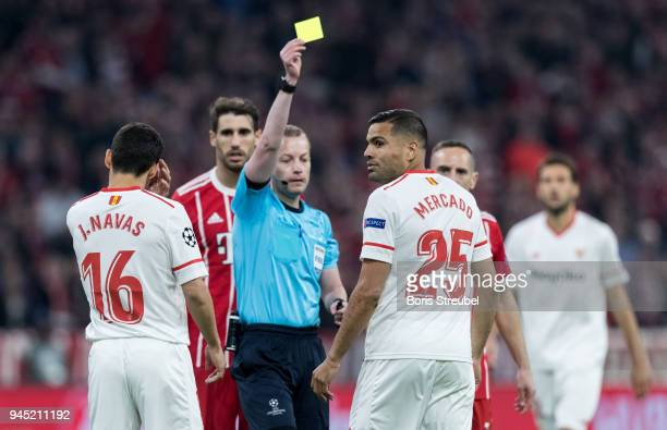 Gabriel Mercado of FC Sevilla is shown a yellow card by referee William Collum during the UEFA Champions League Quarter Final second leg match...