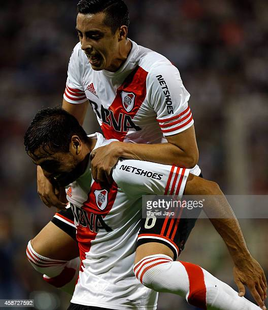 Gabriel Mercado of River Plate celebrates with teammate Ramiro Funes Mori after scoring during a match between Velez Sarsfield and River Plate as...