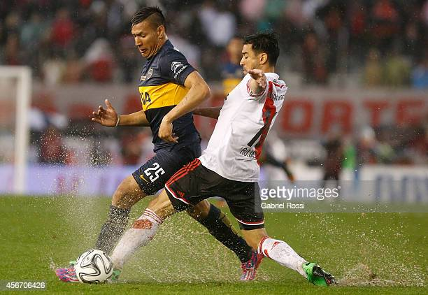 Gabriel Mercado of River Plate fights for the ball with Andres Chavez of Boca Juniors during a match between River Plate and Boca Juniors as part of...