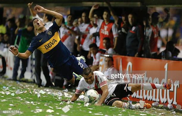 Gabriel Mercado of River Plate fights for the ball with Andres Chavez of Boca Juniors during a first leg semifinal match between Boca Juniors and...