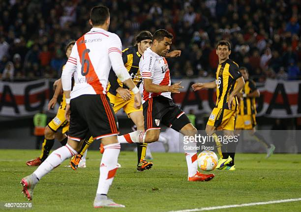 Gabriel Mercado of River Plate kicks the ball to score the opening goal during a first leg Semi Final match between River Plate and Guarani as part...