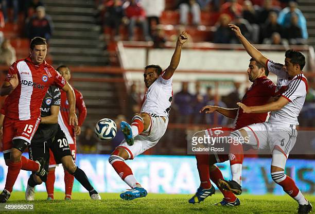 Gabriel Mercado of River Plate kicks the ball to score the opening goal during a match between Argentinos Juniors and River Plate as part of 18th...
