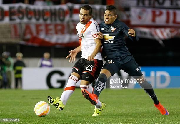 Gabriel Mercado of River Plate Norberto Araujo of Liga de Quito during a first leg match between River Plate and Liga Deportiva Universitaria de...