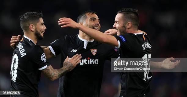 Gabriel Mercado of Sevilla celebrates victory with teammates Ever Banega of Sevilla and Pablo Sarabia of Sevilla during the UEFA Champions League...