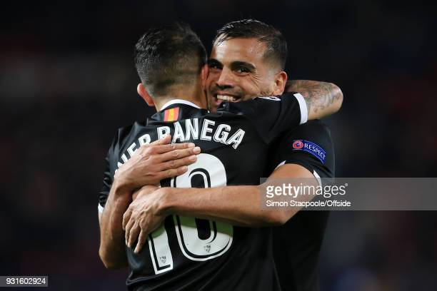 Gabriel Mercado of Sevilla celebrates with teammate Ever Banega of Sevilla during the UEFA Champions League Round of 16 Second Leg match between...