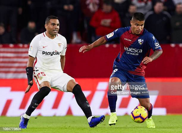 Gabriel Mercado of Sevilla competes for the ball with Juan Camilo Hern‡ndez 'Cucho' of Huesca during the La Liga match between Sevilla FC and SD...