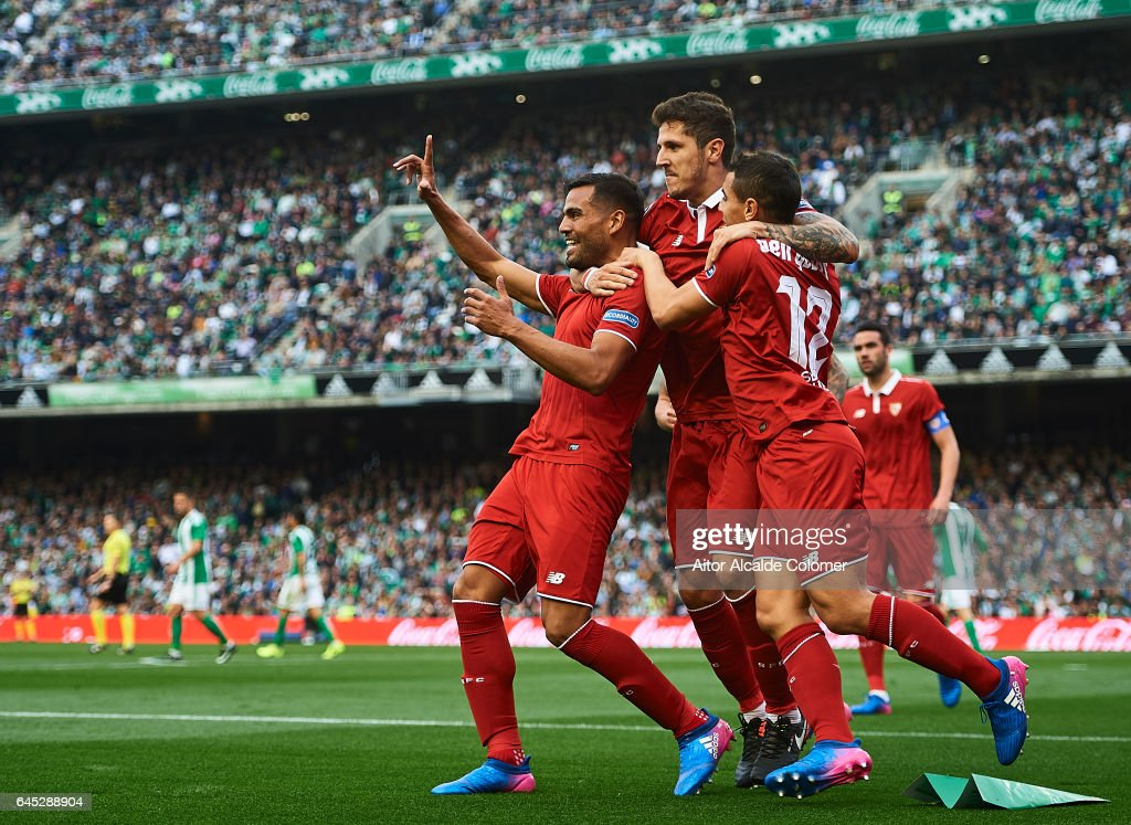 Gabriel Mercado of Sevilla FC celebrates after scoring with his team mates Stevan Jovetic and Wissam Ben Yedder of Sevilla FC during La Liga match between Real Betis Balompie and Sevilla FC at Benito Villamarin Stadium on February 25, 2017 in Seville, Spain.