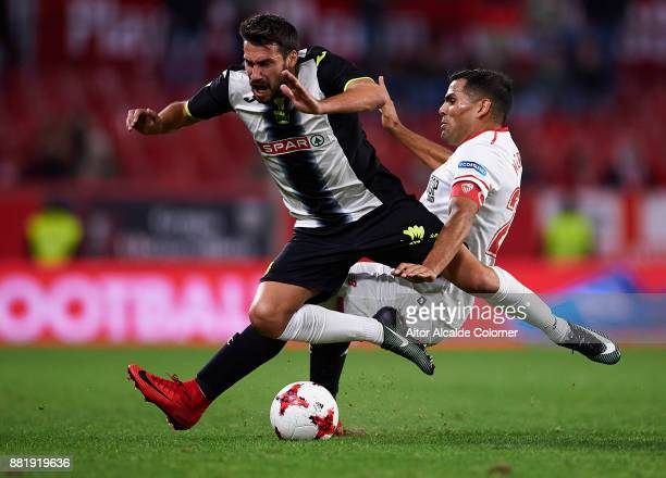 Gabriel Mercado of Sevilla FC competes for the ball with Dani Abalo of FC Cartagena during la Copa del Rey match between Sevilla FC and FC Cartagena...