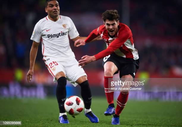 Gabriel Mercado of Sevilla FC competes for the ball with Ibai Gomez of Athletic Club during the Copa del Rey Round of 16 second leg match between...