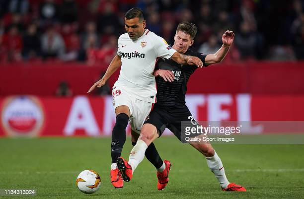 Gabriel Mercado of Sevilla FC competes for the ball with Lukas Masopust of Slavia Prague during the UEFA Europa League Round of 16 First Leg match...