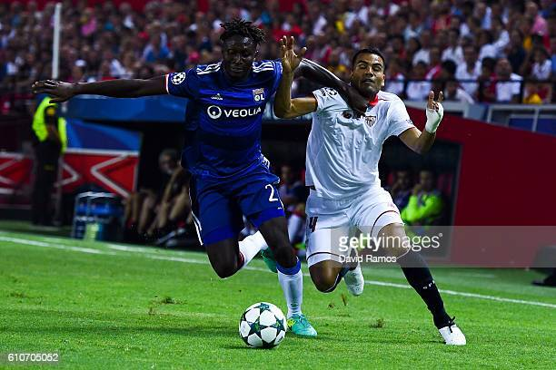 Gabriel Mercado of Sevilla FC competes for the ball with Mapou YangeMbiwa of Olympique Lyonnais the UEFA Champions League Group H match between...