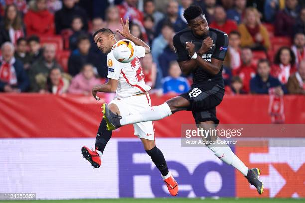 Gabriel Mercado of Sevilla FC competes for the ball with Simon Deli of Slavia Prague during the UEFA Europa League Round of 16 First Leg match...
