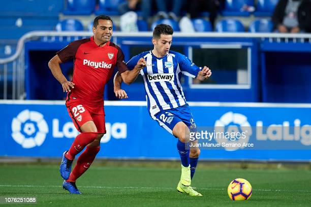 Gabriel Mercado of Sevilla FC duels for the ball with Jonathan Rodriguez of Deportivo Alaves during the La Liga match between Deportivo Alaves and...
