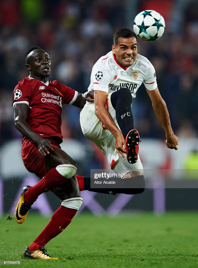 Gabriel Mercado of Sevilla FC duels for the ball with Sadio Mane of Liverpool FC during the UEFA Champions League group E match between Sevilla FC and Liverpool FC at Estadio Ramon Sanchez Pizjuan on November 21, 2017 in Seville, Spain.