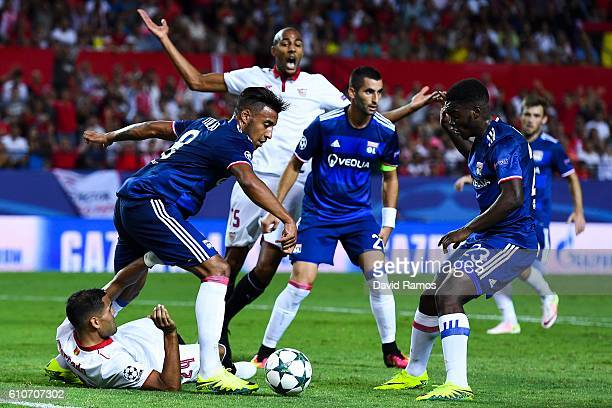 Gabriel Mercado of Sevilla FC is brought down by Corentin Tolisso of Olympique Lyonnais during the UEFA Champions League Group H match between...