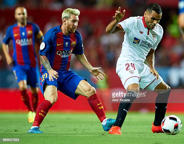 Gabriel Mercado of Sevilla FC is followed by Lionel Messi of FC Barcelona during the match between Sevilla FC vs FC Barcelona as part of the Spanish...