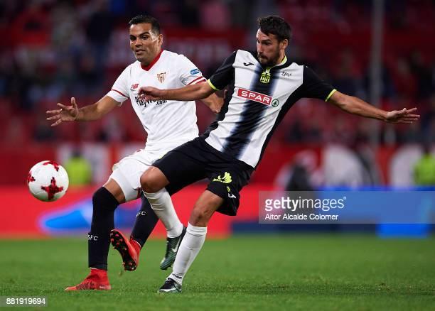 Gabriel Mercado of Sevilla FC (L competes for the ball with Dani Abalo of FC Cartagena during la Copa del Rey match between Sevilla FC and FC...