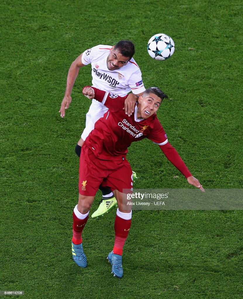 Gabriel Mercado of Sevilla FC wins the ball from Roberto Firmino of Liverpool FC during the UEFA Champions League group E match between Liverpool FC and Sevilla FC at Anfield on September 13, 2017 in Liverpool, United Kingdom.