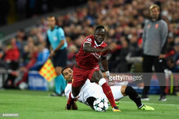 Gabriel Mercado of Sevilla tackles Sadio Mane of Liverpool during the UEFA Champions League group E match between Liverpool FC and Sevilla FC at...