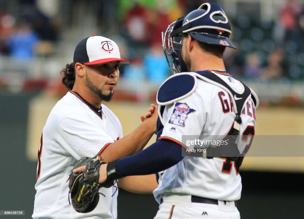 Gabriel Moya #58 of the Minnesota Twins and Mitch Garver #43 of the Minnesota Twins after defeating the Detroit Tigers during their baseball game on October 1, 2017, at Target Field in Minneapolis, Minnesota.