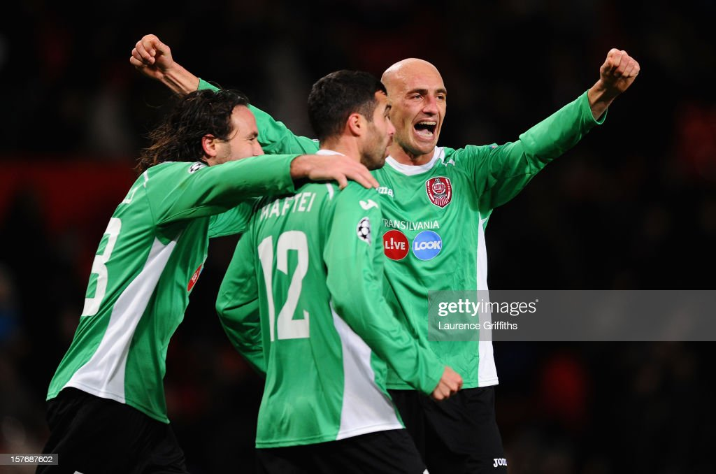 Gabriel Muresan of CFR 1907 Cluj celebrates with his team-mates at the end of the UEFA Champions League Group H match between Manchester United and CFR 1907 Cluj at Old Trafford on December 5, 2012 in Manchester, England.