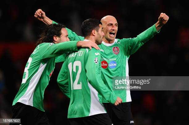 Gabriel Muresan of CFR 1907 Cluj celebrates with his teammates at the end of the UEFA Champions League Group H match between Manchester United and...