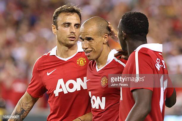 Gabriel Obertan of Manchester United celebrates scoring their first goal with Dimitar Berbatov and Danny Welbeck during the preseason friendly match...