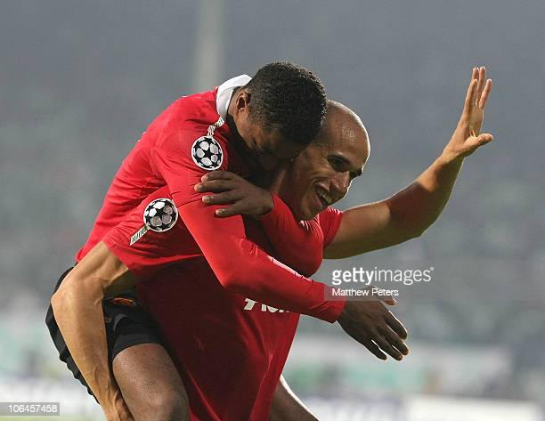 Gabriel Obertan of Manchester United celebrates scoring their second goal with Patrice Evra during the UEFA Champions League Group C match between...