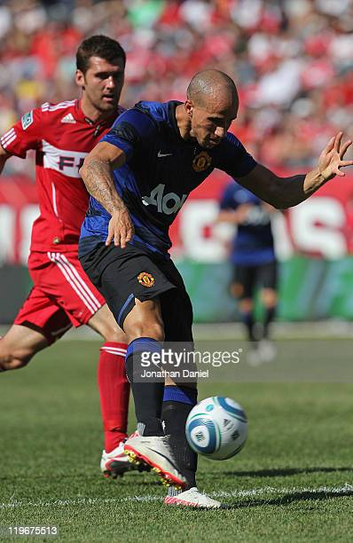 Gabriel Obertan of Manchester United shoots the ball under pressure from Gonzalo Segares of the Chicago Fire in a friendly match during the World...