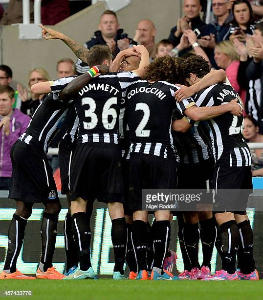 Gabriel Obertan of Newcastle United is conatulated by teammates after scoring the opening goal during the Barclays Premier League match between...
