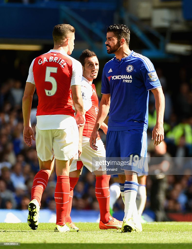 Gabriel of Arsenal and Diego Costa of Chelsea argue during the Barclays Premier League match between Chelsea and Arsenal at Stamford Bridge on September 19, 2015 in London, United Kingdom.