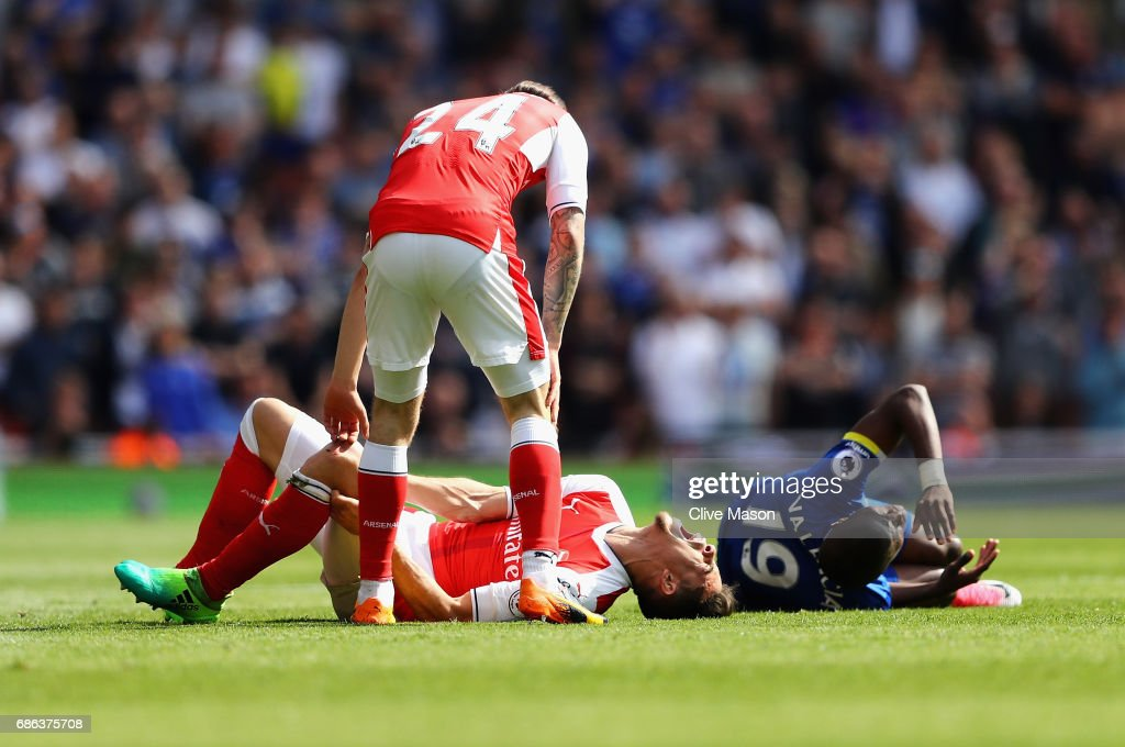Gabriel of Arsenal and Enner Valencia of Everton on the ground after a tackle during the Premier League match between Arsenal and Everton at Emirates Stadium on May 21, 2017 in London, England.