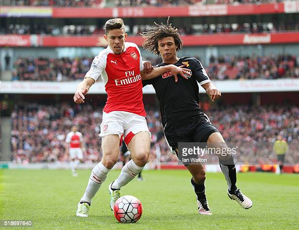 Gabriel of Arsenal and Nathan Ake of Watford compete for the ball during the Barclays Premier League match between Arsenal and Watford at Emirates...
