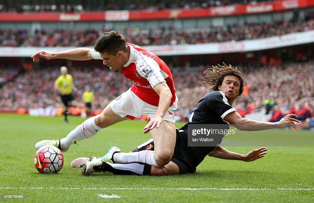 Gabriel of Arsenal and Nathan Ake of Watford compete for the ball during the Barclays Premier League match between Arsenal and Watford at Emirates Stadium on April 2, 2016 in London, England.